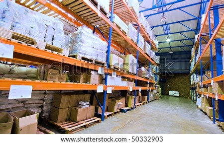 warehouse stacked with goods - stock photo