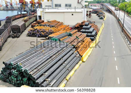 Warehouse steel pipe in the port - stock photo