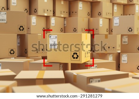 Warehouse storage, packages delivery concept, focus on cardboard box purchase and background with stack of parcels - stock photo