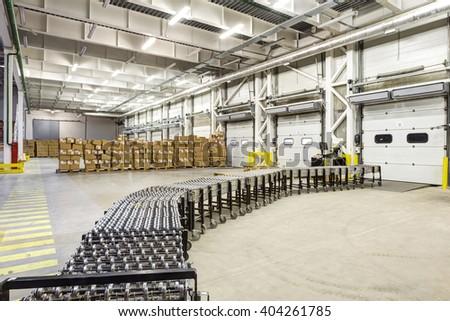 Warehouse, unloading with conveyor belt - stock photo