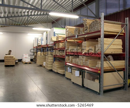 warehouse view with packages pallets and storage shelfs