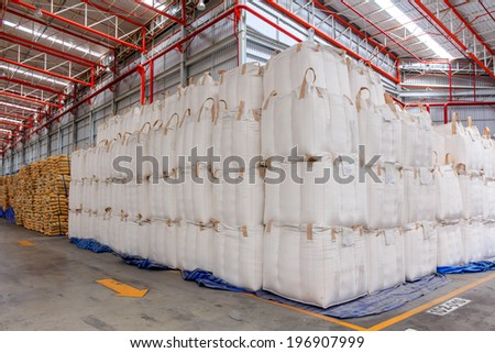 Warehouse with stacked big sacks of meal  - stock photo