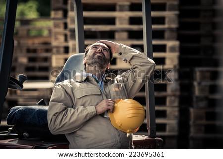 Warehouse worker having a break - stock photo