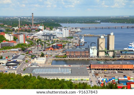 Warehouses, factories and silos at Stockholm sea port. Sweden. - stock photo