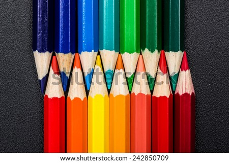 Warm and cold colors presented with colorful pencils - stock photo