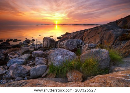 Warm and colorful summer evening sunset in coast of Porkkala, Finland - stock photo