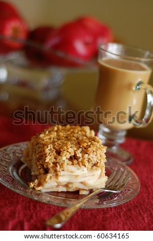 Warm Apple Crisp Served on a Glass Plate with a Cup of Hot Coffee - stock photo