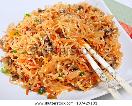 Warm asian salad with cellophane noodles and vegetables. - stock photo