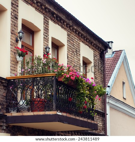 warm balcony with flowers  - stock photo