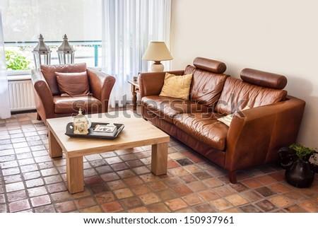 Warm casual contemporary living room interior - stock photo