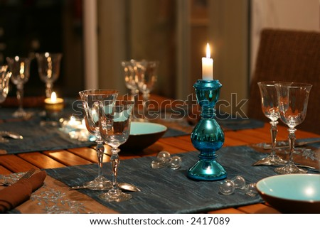 warm celebration table, focus on candlestick