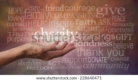 Warm Charity Word Wall  - Woman's outstretched open hand with the word 'charity' in white above palm, surrounded by charity related words on a rustic orange and purple stone effect background  - stock photo