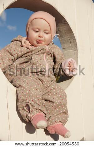 warm clothing happy baby girl - stock photo