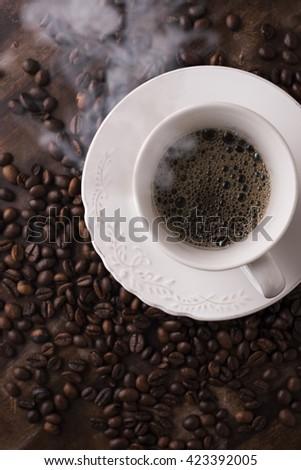 Warm coffee with coffee beans - stock photo