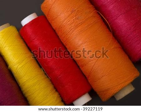 warm colored bobbins - stock photo