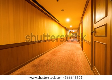 warm corridor in the hotel with carpet - stock photo