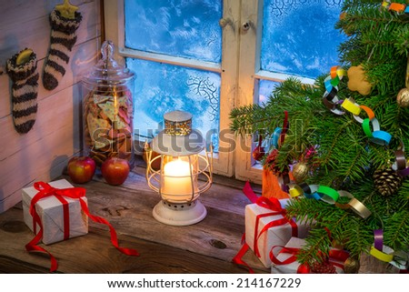 Warm cottage in a Christmas evening - stock photo