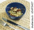 warm couscous salad with dried tomatoes and capers - stock photo