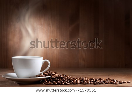 warm cup of coffee on brown background - stock photo