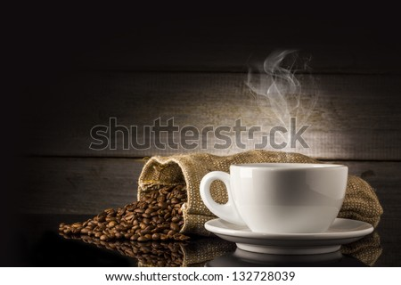 warm cup of coffee on wooden background - stock photo