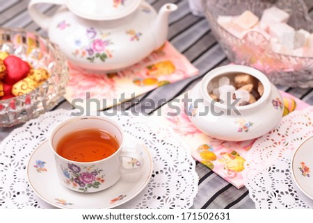 Warm cup of tea with sweets and candies