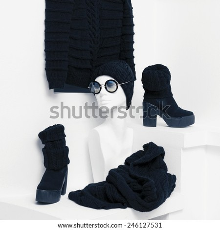 Warm Fashionable Clothing. Trend knitted garments. Sweater, hat and knitted accessories for women. Black accent style - stock photo