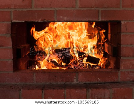 Warm flames burning in a fireplace - stock photo