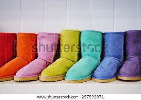 Warm, fuzzy sheepskin Australian boots in many colors - stock photo