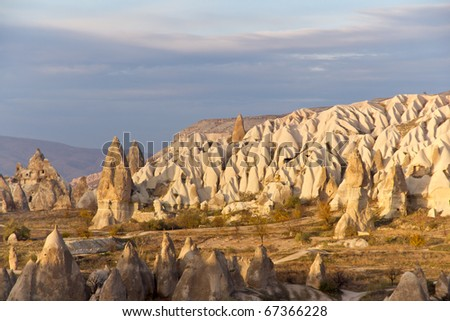 Warm Glow of Sunset on the Fairy Chimneys of Cappadocia, Popular Travel Destination in Central Turkey - stock photo