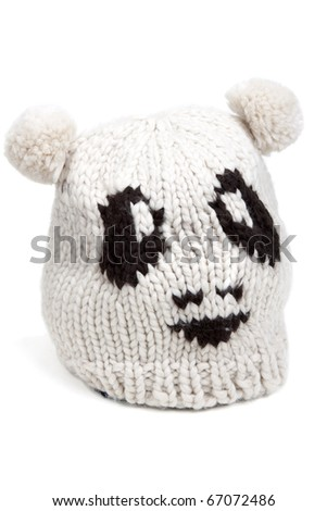 Warm hat patterned with a person on a white background - stock photo