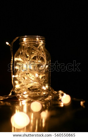 Warm light LED and a jar with dark background