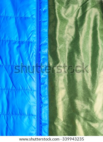 warm light weight  insulated  texture of jacket  with heat keeper inside,on white background. - stock photo