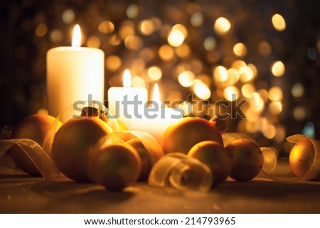 Warm Night Christmas decorations  with candles, baubles and ribbons on magic  bokeh background - stock photo