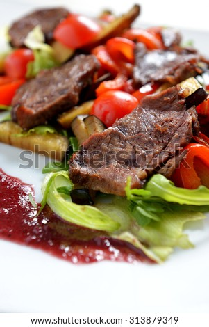 warm salad with grilled meat and vegetables