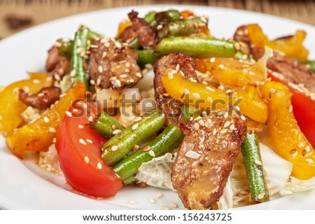 Warm salad with veal closeup
