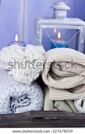 Warm scarfs with candles, selective focus - stock photo