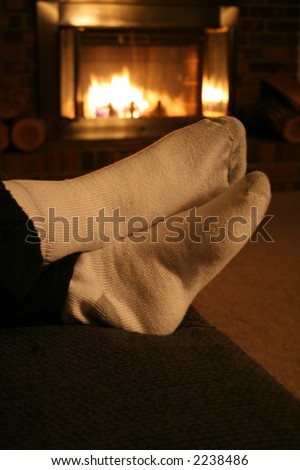 Warm Scene - Resting by the Fire during the winter for a nice Holiday feeling. - stock photo