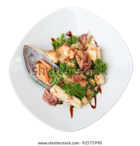 warm seafood salad with potatoes on white dish isolated over white. top view. - stock photo