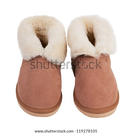 Warm slippers of wool on a white background - stock photo