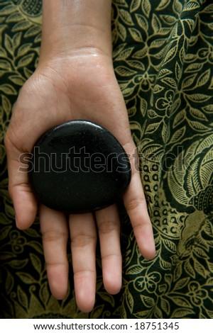 warm stone spa therapy - stock photo