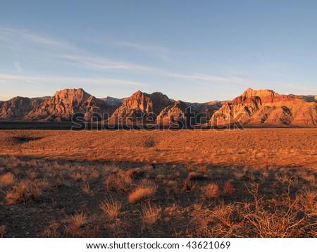 Warm sunrise light at Nevada's Red Rock Recreation Area. - stock photo