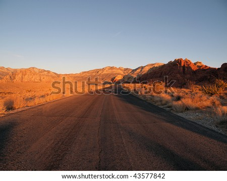 Warm sunrise light on Red Rock Scenic Loop Road near Las Vegas Nevada. - stock photo