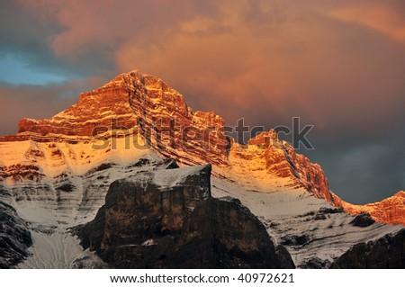 Warm sunrise on mountains - stock photo