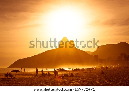Warm Sunset on Ipanema Beach with People, Rio de Janeiro, Brazil - stock photo