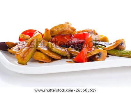 Warm thai salad on white plate over white background - stock photo