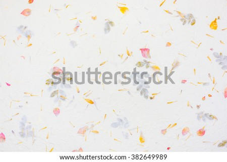 warm white rough mulberry paper with red and yellow flower texture  background and wallpaper  - stock photo
