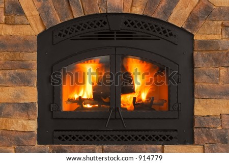 Warm Winter Fire with wood, flames, ash, embers and charcoal - stock photo