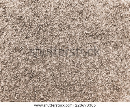 Warm wool colored cloth with sheep curled nap. Background useful new year cards and swatch for winter fashion collections - stock photo