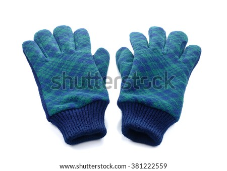 Warm woolen knitted gloves isolated on a white background