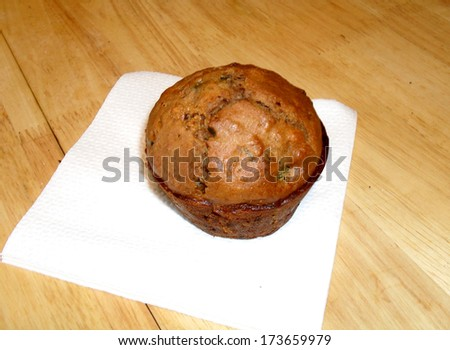 warm zucchini muffin cooling on kitchen table - stock photo